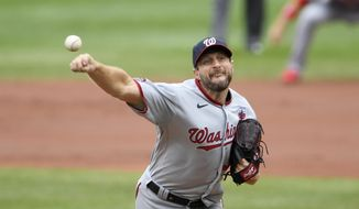 Washington Nationals starting pitcher Max Scherzer delivers a pitch during the first inning of a baseball game against the Baltimore Orioles, Sunday, Aug. 16, 2020, in Baltimore. (AP Photo/Nick Wass)