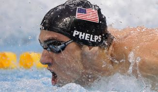 United States swimmer Michael Phelps wins the gold in the men's 4x100-meter medley relay final during the swimming competitions in the National Aquatics Center at the Beijing 2008 Olympics in Beijing, Sunday, Aug. 17, 2008. (AP Photo/Mark J. Terrill) **FILE**