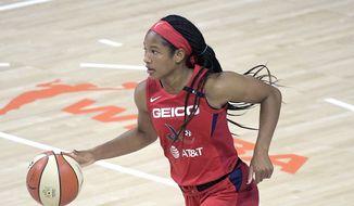 Washington Mystics guard Stella Johnson brings the ball up the court during the second half of a WNBA basketball game against the Las Vegas Aces, Saturday, Aug. 15, 2020, in Bradenton, Fla. (AP Photo/Phelan M. Ebenhack)  **FILE**