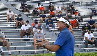 Auburn coach Gus Malzahn talks to players during the first team meeting of the season for the NCAA college football team, Sunday, Aug. 16, 2020, in Auburn, Ala. (AP Photo/Todd Van Emst via AP)