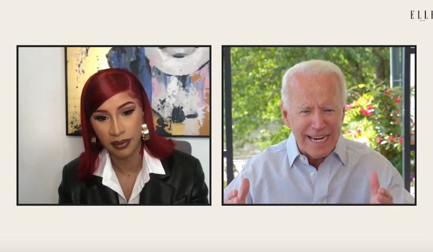 Then-presumptive presidential nominee Joe Biden sat down with rapper Cardi B for a friendly discussion Monday, Aug. 17, 2020, amid mounting criticism that he has been avoiding questions from reporters ahead of the Democratic National Convention. (Screengrab via Elle magazine) ** FILE **