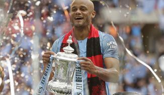 FILE - In this file photo dated Saturday, May 18, 2019, Manchester City's team captain Vincent Kompany lifts the trophy after winning the English FA Cup Final soccer match between Manchester City and Watford at Wembley stadium in London. The 34-year old Vincent Kompany who left Manchester City in 2019, has ended his 17-year playing career to focus on being head coach of Belgian team Anderlecht, it is announced Monday Aug. 17, 2020.(AP Photo/Tim Ireland, FILE)