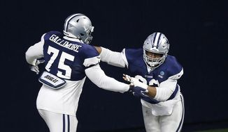 Dallas Cowboys defensive tackle Gerald McCoy (93) runs through a drill with Cowboys defensive tackle Neville Gallimore (75) during NFL football training camp in Frisco, Texas on Monday, Aug. 17, 2020. (Vernon Bryant/The Dallas Morning News via AP)  **FILE**