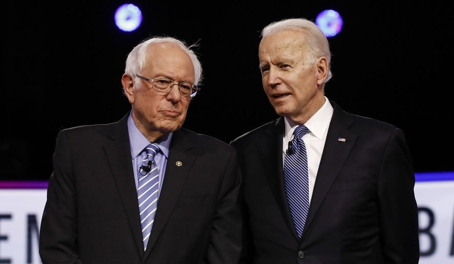In this Feb. 25, 2020 file photo, Democratic presidential candidates, Sen. Bernie Sanders, I-Vt., left, and former Vice President Joe Biden, talk before a Democratic presidential primary debate in Charleston, S.C. (AP Photo/Matt Rourke, File)