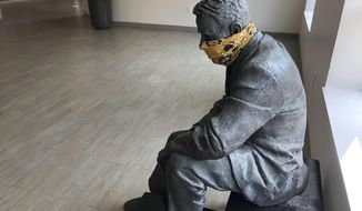 A statue is masked inside a building on the first day of classes Monday, August 17, 2020, at Georgia Tech in Atlanta. More of Georgia's public universities are opening for the fall term, trying to balance concern about COVID-19 infections against a mandate for on-campus classes citing financial needs and student desires (AP Photo/Jeff Amy)
