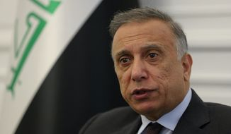 Iraqi Prime Minister Mustafa al-Kadhimi speaks during an interview with The Associated Press in Baghdad, Iraq, Monday, Aug. 17, 2020. (AP Photo/Khalid Mohammed)