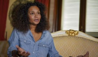 Fashion designer Stella Jean talks during an interview with the Associated Press, in Rome, Thursday, Aug. 13, 2020. Stella Jean, a Haitian-Italian designer born and raised in Rome, launched her appeal this summer. She asked the Italian National Fashion Chamber and the global powerhouses steering it, including Prada, Ferragamo and Zegna, to back their social media pledges supporting the Black Lives Matter movement with concrete, transparent commitments toward greater racial diversity. (AP Photo/Andrew Medichini)