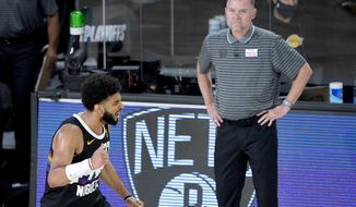 Denver Nuggets' Jamal Murray, left, reacts near head coach Michael Malone after a play against the Utah Jazz during the second half of an NBA basketball first round playoff game, Monday, Aug. 17, 2020, in Lake Buena Vista, Fla. (AP Photo/Ashley Landis, Pool)