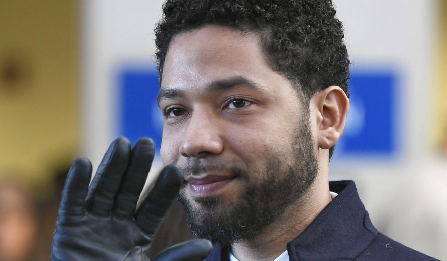 FILE - In this March 26, 2019, file photo, actor Jussie Smollett smiles and waves to supporters before leaving Cook County Court after his charges were dropped in Chicago. A special prosecutor in Chicago says Cook County State's Attorney Kim Foxx and her office abused their discretion in the case against actor Jussie Smollett but did nothing criminal. (AP Photo/Paul Beaty, File)