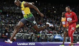 FILE - In this Aug. 5, 2012, file photo, Jamaica's Usain Bolt crosses the finish line to win gold in the men's 100-meter final in the Olympic Stadium at the 2012 Summer Olympics in London. (AP Photo/David J. Phillip, File)