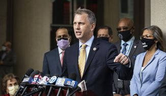 Flanked by other members of the Illinois congressional delegation, U.S. Rep. Sean Casten speaks about the importance of the United States Postal Service during a press conference outside the USPS Chicago Headquarters, Tuesday morning, Aug. 18, 2020. (Ashlee Rezin Garcia/Chicago Sun-Times via AP) ** FILE **