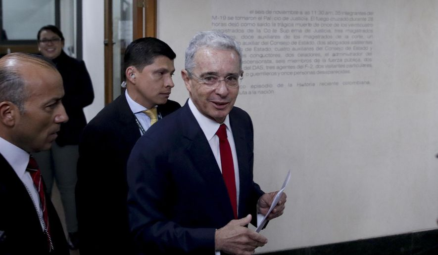 FILE - In this Oct. 8, 2019 file photo, senator and former president Alvaro Uribe arrives to the Supreme Court for questioning in an investigation for witness tampering charges in Bogota, Colombia. Uribe announced his resignation from the Senate Tuesday, Aug. 18, 2020, while he is investigated by the Supreme Court for possible witness tampering in a case that has polarized the nation. (AP Photo/Ivan Valencia, File)