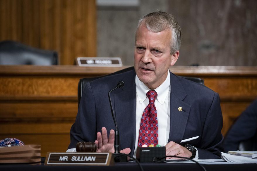 FILE - In this May 7, 2020, file photo, Sen. Dan Sullivan, R-Alaska, testifies during a hearing on Capitol Hill in Washington. Sen. Sullivan, an Alaska Republican, is unopposed in the Alaska Republican Primary on Aug. 18, 2020. Sullivan, who is seeking a second term, will face the winner of the Democratic primary, which includes the leading candidate, Al Gross, who is running as nonpartisan. (Al Drago/Pool via AP, File)
