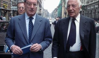 FILE -- May 31, 1988 file photo of Gianni Agnelli, right, chairman of Italy's auto giant FIAT, and chief operating officer Cesare Romiti, as they leave the Banca d'Italia (Bankitalia)in Rome. Romiti has died Tuesday, Aug. 18, 2020, in his house in Milan at the age of 97, according to Italian media. (AP Photo/Gianni Foggia, file)