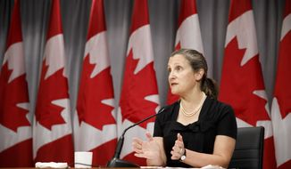 Canada's Deputy Prime Minister Chrystia Freeland speaks during a news conference in Toronto, Friday, Aug. 7, 2020.  (Cole Burston/The Canadian Press via AP)