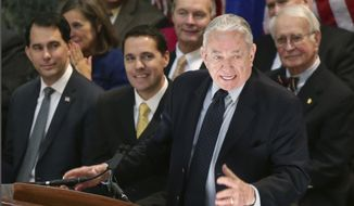 FILE - In this Jan. 31, 2017, file photo, former Wisconsin Gov. Tommy Thompson speaks at the State Capitol in Madison, Wis. Interim University of Wisconsin System President Tommy Thompson wants the governor to give the system a nearly $100 million boost in the next state budget. Thompson announced Tuesday, Aug. 18, 2020 that he plans to ask Gov. Tony Evers to increase state aid to the system by $95.7 million in the 2021-23 state budget.(Michael P. King/Wisconsin State Journal via AP, File)