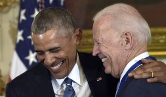 In this Jan. 12, 2017, file photo, President Barack Obama laughs with Vice President Joe Biden during a ceremony in the State Dining Room of the White House in Washington where Obama presented Biden with the Presidential Medal of Freedom. (AP Photo/Susan Walsh) ** FILE **