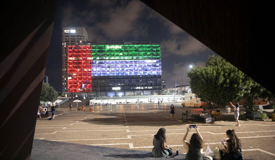 In this Thursday, Aug. 13, 2020, file photo, the Tel Aviv City Hall is lit up with the flag of the United Arab Emirates as Israel and the UAE announced they would be establishing full diplomatic ties, in Tel Aviv, Israel. (AP Photo/Oded Balilty, File)