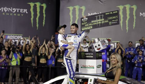 In this Saturday, May 18, 2019, file photo, Kyle Larson celebrates in Victory Lane after winning the NASCAR All-Star Race at Charlotte Motor Speedway in Concord, N.C. Larson has been working behind the scenes to educate himself on racial issues since his firing from NASCAR for using a racial slur. (AP Photo/Chuck Burton, File)  **FILE**