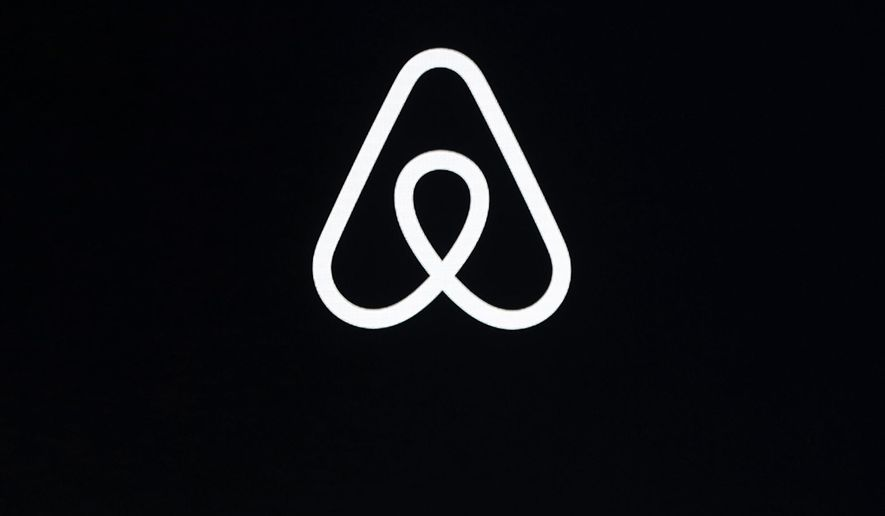 This Feb. 22, 2018, file photo shows an Airbnb logo during an event in San Francisco.  (AP Photo/Eric Risberg, File)  **FILE**