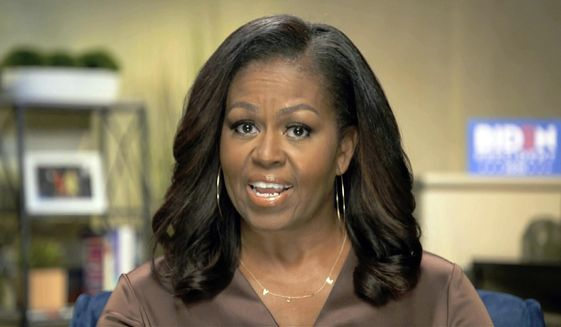 In this image from video, former first lady Michelle Obama speaks during the first night of the Democratic National Convention on Monday, Aug. 17, 2020. (Democratic National Convention via AP)