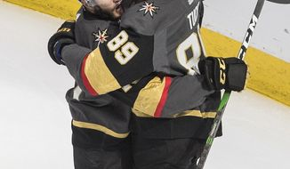 Vegas Golden Knights' Nicolas Roy (10) and Alex Tuch (89) celebrate a goal against the Chicago Blackhawks during the third period in Game 5 of an NHL hockey first-round playoff series, Tuesday, Aug. 18, 2020, in Edmonton, Alberta. (Jason Franson/The Canadian Press via AP)