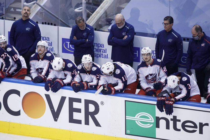 The Columbus Blue Jackets are seen on their bench after losing 5-4 to the Tampa Bay Lightning in an Eastern Conference Stanley Cup first round playoff game in Toronto, Wednesday, Aug. 19, 2020. (Cole Burston/The Canadian Press via AP)