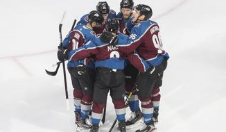 The Colorado Avalanche celebrate a goal against the Arizona Coyotes during first period NHL Western Conference Stanley Cup playoff hockey action in Edmonton, Alberta on Wednesday, Aug. 19, 2020. (Jason Franson/The Canadian Press via AP)