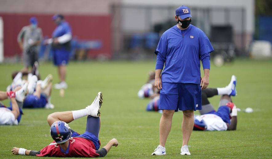 New York Giants head coach Joe Judge talks to his quarterbacks during practice at the NFL football team's training camp in East Rutherford, N.J., Wednesday, Aug. 19, 2020. (AP Photo/Seth Wenig)