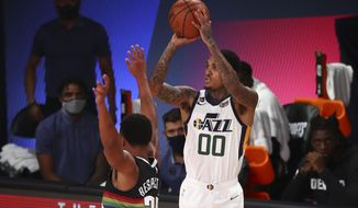 Utah Jazz guard Jordan Clarkson (00) shoots the basketball against Denver Nuggets guard PJ Dozier (35) in game Game 2 of an NBA basketball first-round playoff series, Wednesday, Aug. 19, 2020, in Lake Buena Vista, Fla. (Kim Klement/Pool Photo via AP)
