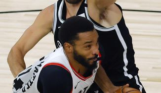 Norman Powell of the Toronto Raptors drives to the basket against Joe Harris of the Brooklyn Nets during the fourth quarter of Game 2 of an NBA basketball first-round playoff series, Wednesday, Aug. 19, 2020, in Lake Buena Vista, Fla. (Kevin C. Cox/Pool Photo via AP)