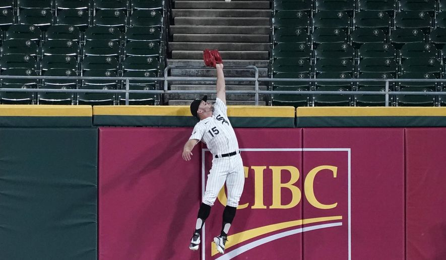 Chicago White Sox center fielder Adam Engel can't make the play on a ball hit for a three-run home run by Detroit Tigers' Jeimer Candelario during the fifth inning of a baseball game in Chicago, Wednesday, Aug. 19, 2020. (AP Photo/Nam Y. Huh)