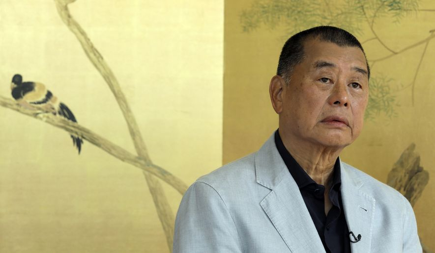 FILE - In this July 1, 2020, file photo, Hong Kong media tycoon Jimmy Lai pauses during an interview in Hong Kong. Governments around the world are taking advantage of the coronavirus pandemic to justify crackdowns on press freedom. Lai was arrested in Hong Kong earlier in August 2020 as police enforced a new national security law. (AP Photo/Vincent Yu, File)