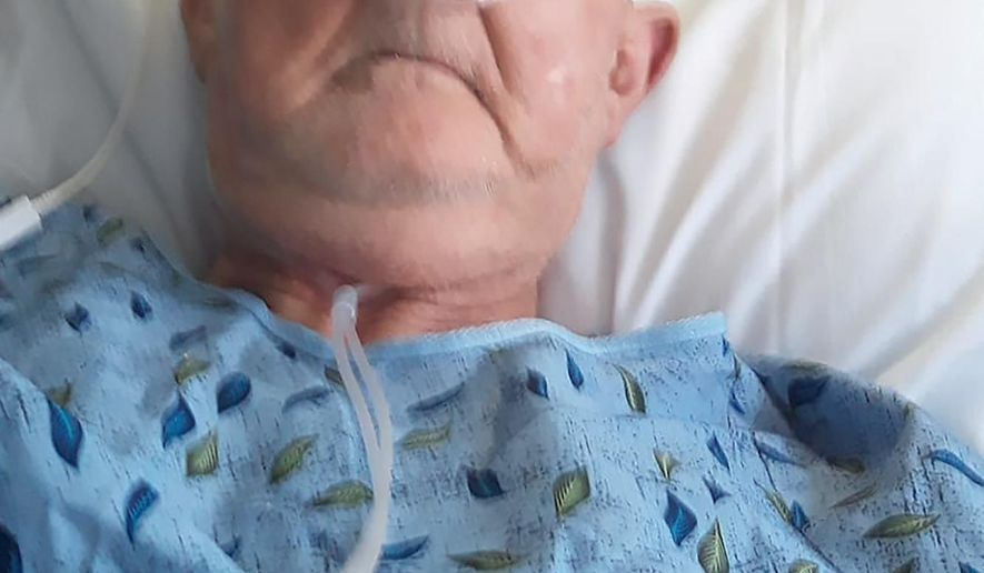In this undated self-made photo, Noel Alexander is seen in the hospital in Louisiana. Alexander had helped build Pine Hill Baptist Church in west-central Louisiana. He'd been its music minister, served on numerous committees and he and his wife kept the church's books. After he died from COVID-19 at age 79, his visitation and funeral were scheduled for the church he loved. But his family said that when they arrived, they were told they couldn't hold either the visitation or the funeral in the spacious building currently used for services because of the pandemic. Pastor Tri Evans says the church voted recently to apologize and create a new fund in Alexander's honor.(Noel Alexander via AP)