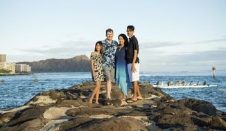 This May 2019 photo provided by Lori Ford, shows Republican state House of Representatives candidate Lori Ford with her husband Scott Ford, daughter Sasha and son Maxwell in Honolulu. The Hawaii attorney general's office denies threatening Ford with arrest for violating a traveler quarantine. Lori Ford was in California visiting family when Hawaii imposed a 14-day quarantine on arriving travelers. (Courtesy of Lori Ford via AP)