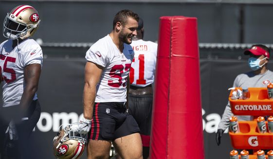 San Francisco 49ers defensive end Nick Bosa (97) walks in beat to the music during NFL Training Camp practice Saturday, Aug. 15, 2020, at the SAP Performance Facility in Santa Clara, Calif. (Xavier Mascarenas/The Sacramento Bee via AP)