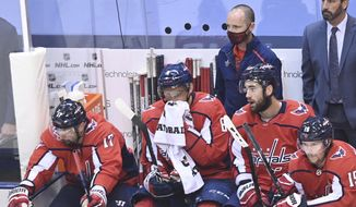 Washington Capitals captain Alex Ovechkin, second left, and teammates watch the final minute of the third period against the New York Islanders of an NHL Stanley Cup playoff hockey game in Toronto on Thursday, Aug. 20, 2020. (Nathan Denette/The Canadian Press via AP)