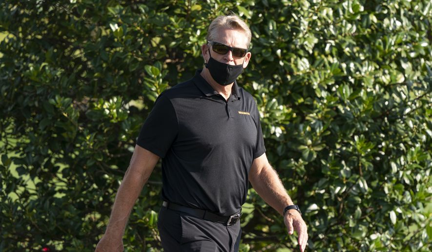 Washington defensive coordinator Jack Del Rio arrives for practice at the team's NFL football training facility, Thursday, Aug. 20, 2020, in Ashburn, Va. (AP Photo/Alex Brandon)