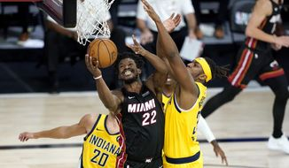 Miami Heat's Jimmy Butler (22) shoots as Indiana Pacers' Myles Turner defends during the second half of an NBA basketball first round playoff game, Thursday, Aug. 20, 2020, in Lake Buena Vista, Fla. (AP Photo/Ashley Landis, Pool)