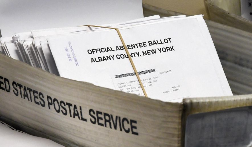 FILE - In this June 30, 2020, file photo, a box of absentee ballots wait to be counted at the Albany County Board of Elections in Albany, N.Y.  New York will allow voters to request absentee ballots for the general election because of coronavirus under a new state law signed Thursday, Aug. 20. Lawmakers passed the bill last month, and voting rights groups have been calling on Gov. Andrew Cuomo to sign the legislation for weeks. (AP Photo/Hans Pennink, File)