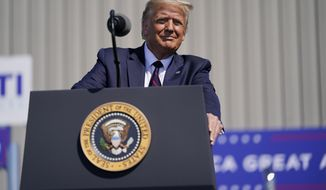 President Donald Trump speaks to a crowd of supporters during a campaign stop at Mariotti Building Product, Thursday, Aug. 20, 2020, in Old Forge, Pa. (AP Photo/Evan Vucci)
