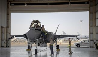 In this Aug. 5, 2019, photo released by the U.S. Air Force, an F-35 fighter jet pilot and crew prepare for a mission at Al-Dhafra Air Base in the United Arab Emirates. (Staff Sgt. Chris Thornbury/U.S. Air Force via AP) **FILE**