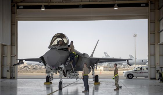 In this Aug. 5, 2019, file photo released by the U.S. Air Force, an F-35 fighter jet pilot and crew prepare for a mission at Al-Dhafra Air Base in the United Arab Emirates. (Staff Sgt. Chris Thornbury/U.S. Air Force via AP) ** FILE **
