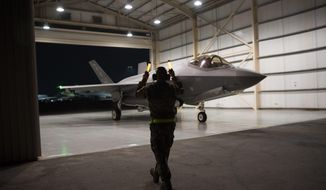 In this Sept. 10, 2019, photo released by the U.S. Air Force, an F-35A Lightning II fighter jet is directed out of a hangar at Al-Dhafra Air Base in the United Arab Emirates. A U.S.-brokered deal that saw Israel and the United Arab Emirates begin to open diplomatic ties may end up with Abu Dhabi purchasing advanced American weaponry like the F-35, potentially upending both a longstanding Israeli military edge regionally and the balance of power with Iran. (Tech. Sgt. Jocelyn A. Ford/U.S. Air Force via AP)