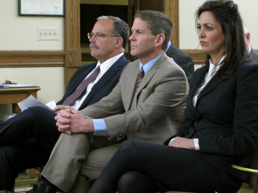 FILE - In this Nov. 13, 2108, file photom Montana Secretary of State Corey Stapleton is flanked by his elections director Dana Corson, right, and chief of staff Christi Jacobsen as they wait to testify before a legislative committee in Helena, Mont. Stapleton, a Republican, said Thursday, Aug. 20, 2020, he is appealing to the U.S. Supreme Court to overturn a ruling that took the Montana Green Party off the November ballot after Republicans bankrolled the effort to get them on it. (AP Photo/Matt Volz,File)