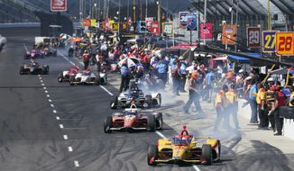 Ryan Hunter-Reay leads a group of cars off pit lane during a practice session for the Indianapolis 500 auto race at Indianapolis Motor Speedway, Sunday, Aug. 16, 2020, in Indianapolis. (AP Photo/Darron Cummings)