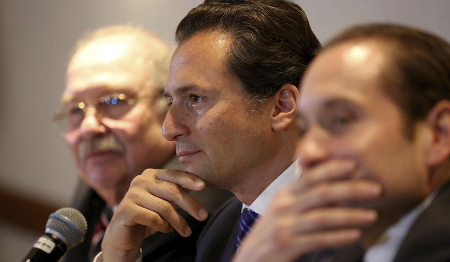 FILE - In this Aug. 17, 2017 file photo, flanked by his lawyers, Emilio Lozoya, former head of Mexico's state-owned oil company Pemex, attends a press conference in Mexico City. The alleged examples of kickbacks, bribes and graft contained in accusations by Lozoya on Wednesday, Aug. 20, 2020, include that one government contractor gave then-President Enrique Pena Nieto a Ferrari sports car. (AP Photo/Gustavo Martinez Contreras, File)