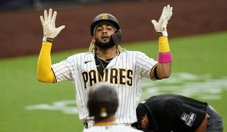 San Diego Padres' Fernando Tatis Jr. reacts after hitting a home run during the third inning of a baseball game against the Texas Rangers, Wednesday, Aug. 19, 2020, in San Diego. (AP Photo/Gregory Bull)