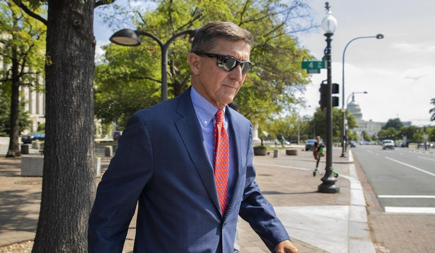 In this Sept. 10, 2019, file photo, Michael Flynn, President Donald Trump's former national security adviser, leaves the federal court following a status conference in Washington. (AP Photo/Manuel Balce Ceneta, File)