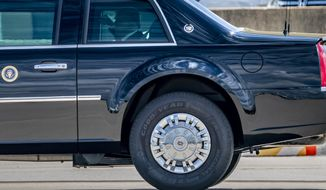 "In a photo from Friday, Aug. 14, 2020, President Donald Trump rides in the heavily armored limousine known as ""the beast"" which rolls on specially-made Goodyear tires, at Joint Base Andrews in Suitland, Md. Trump is urging people not to buy tires from Goodyear amid claims that the Ohio-based manufacturer has banned his MAGA campaign hats. (AP Photo/J. Scott Applewhite)"